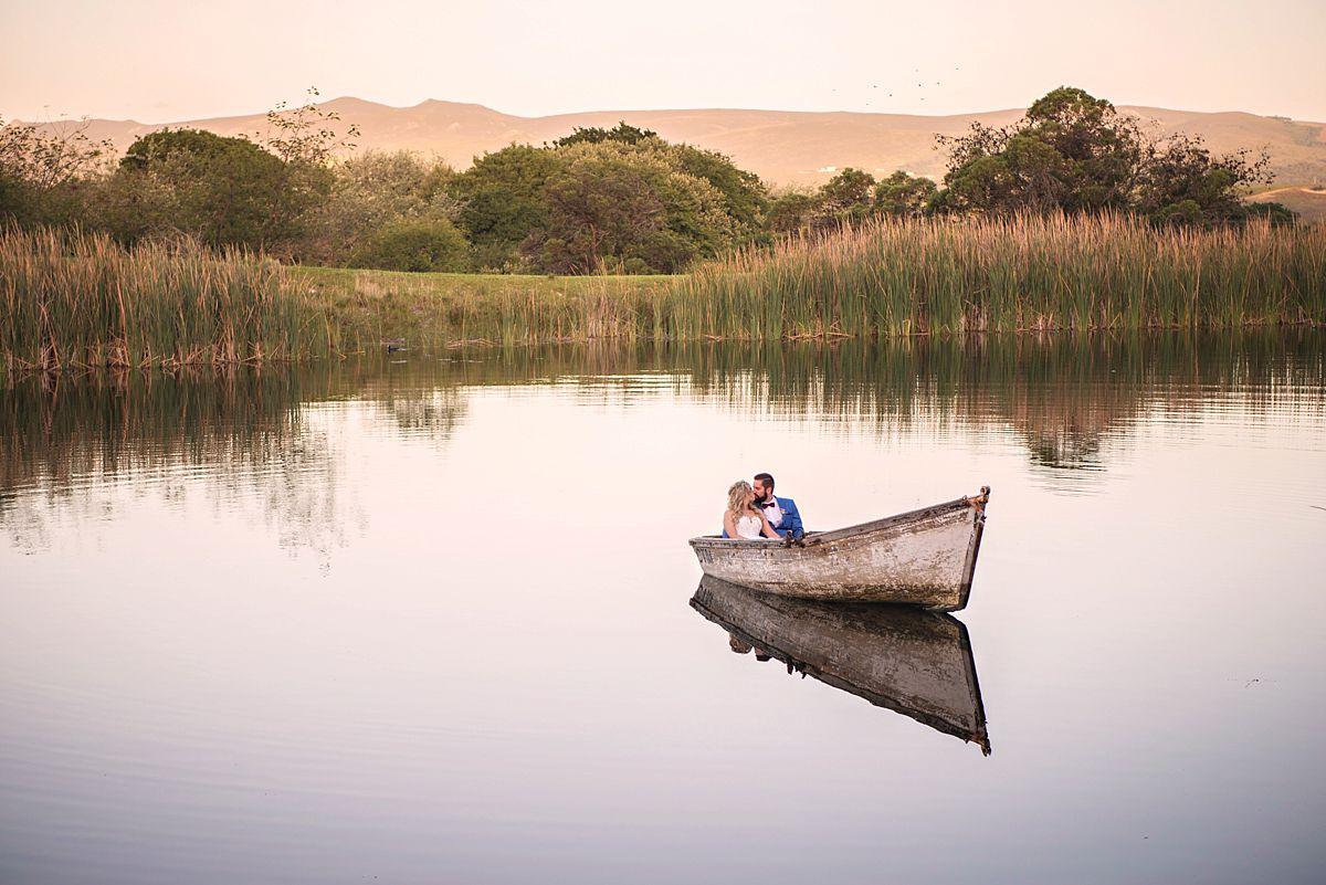 wedding couple rowboat on dam