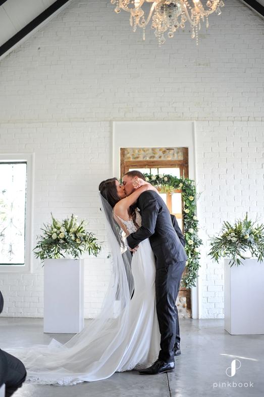 groom kiss the bride