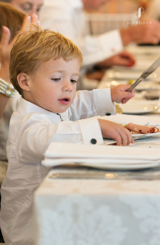 cute child at a wedding table