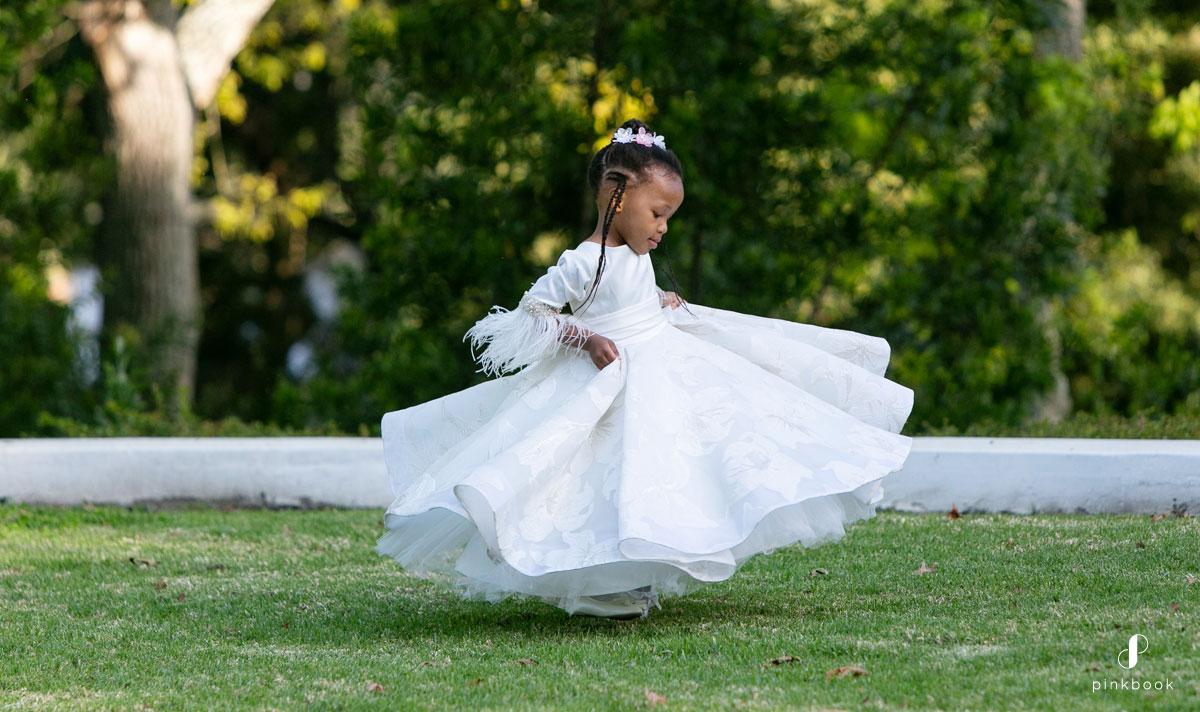dancing flower girl in white dress