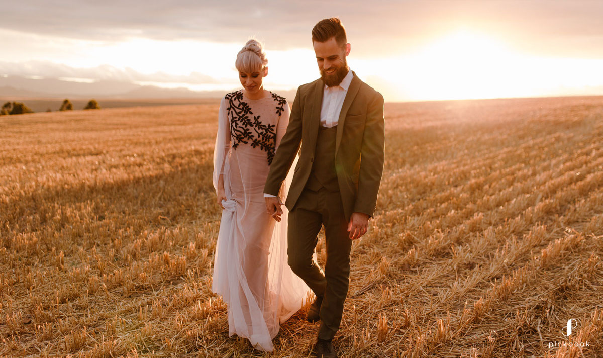 beautiful couple walking on a open field