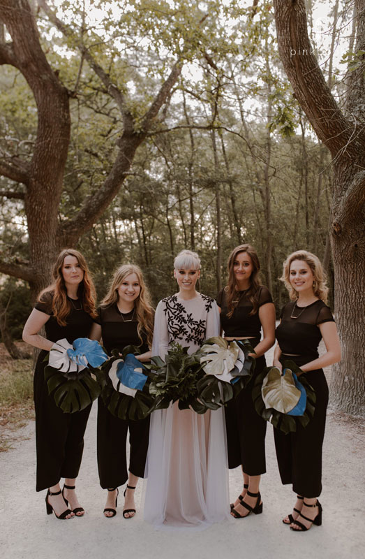 Bride and her ladies standing by her side.