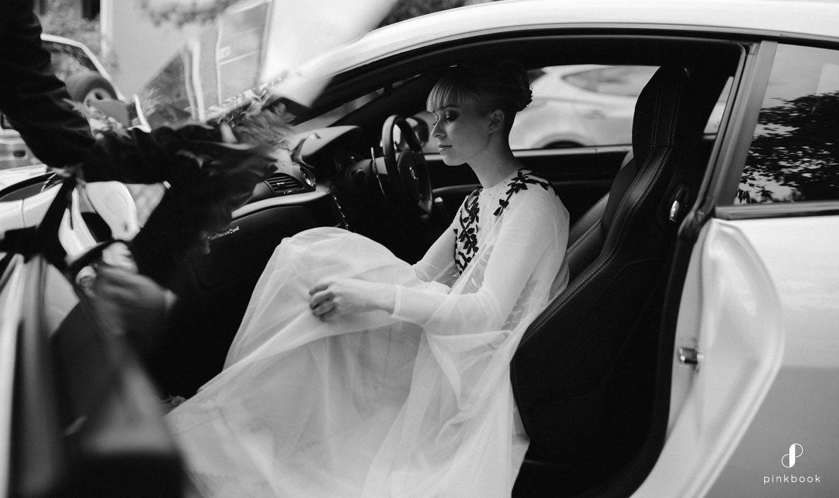 Bride climbing into the car