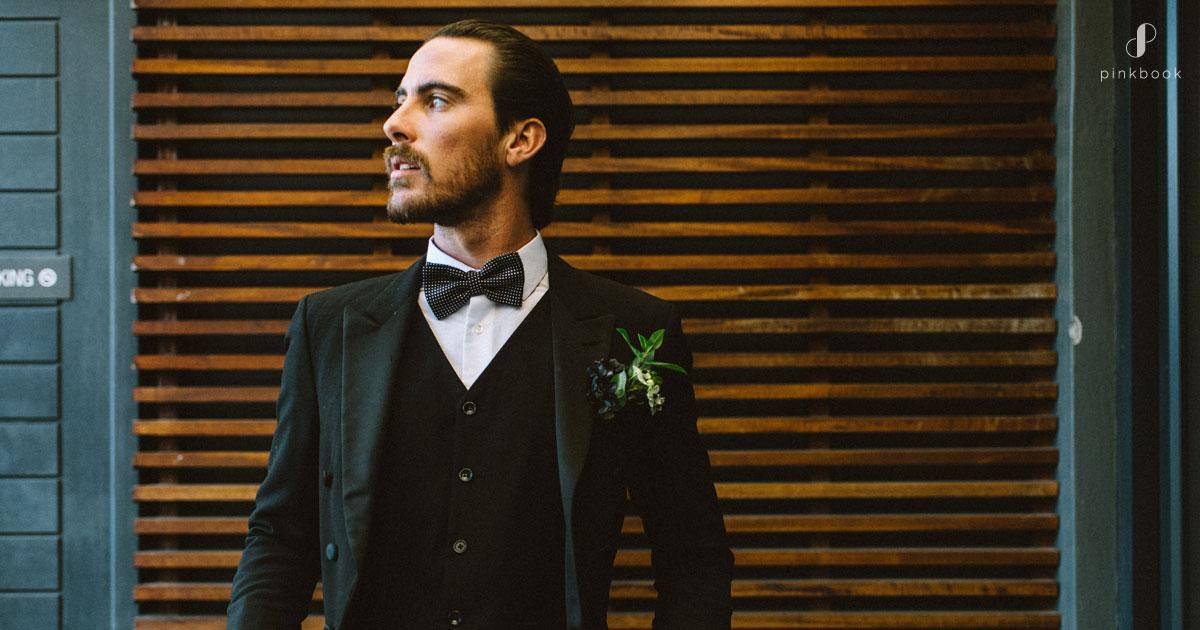 groom in top hat suit