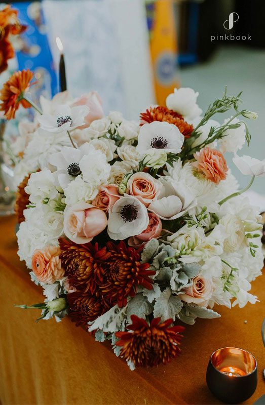 white and orange flower centerpieces