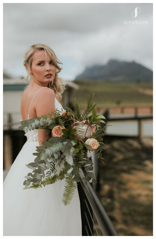 Outside bride with flowers