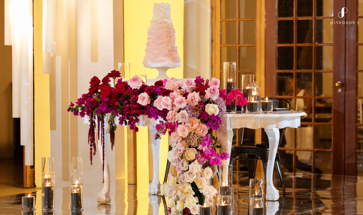 bride and groom table on wedding stage