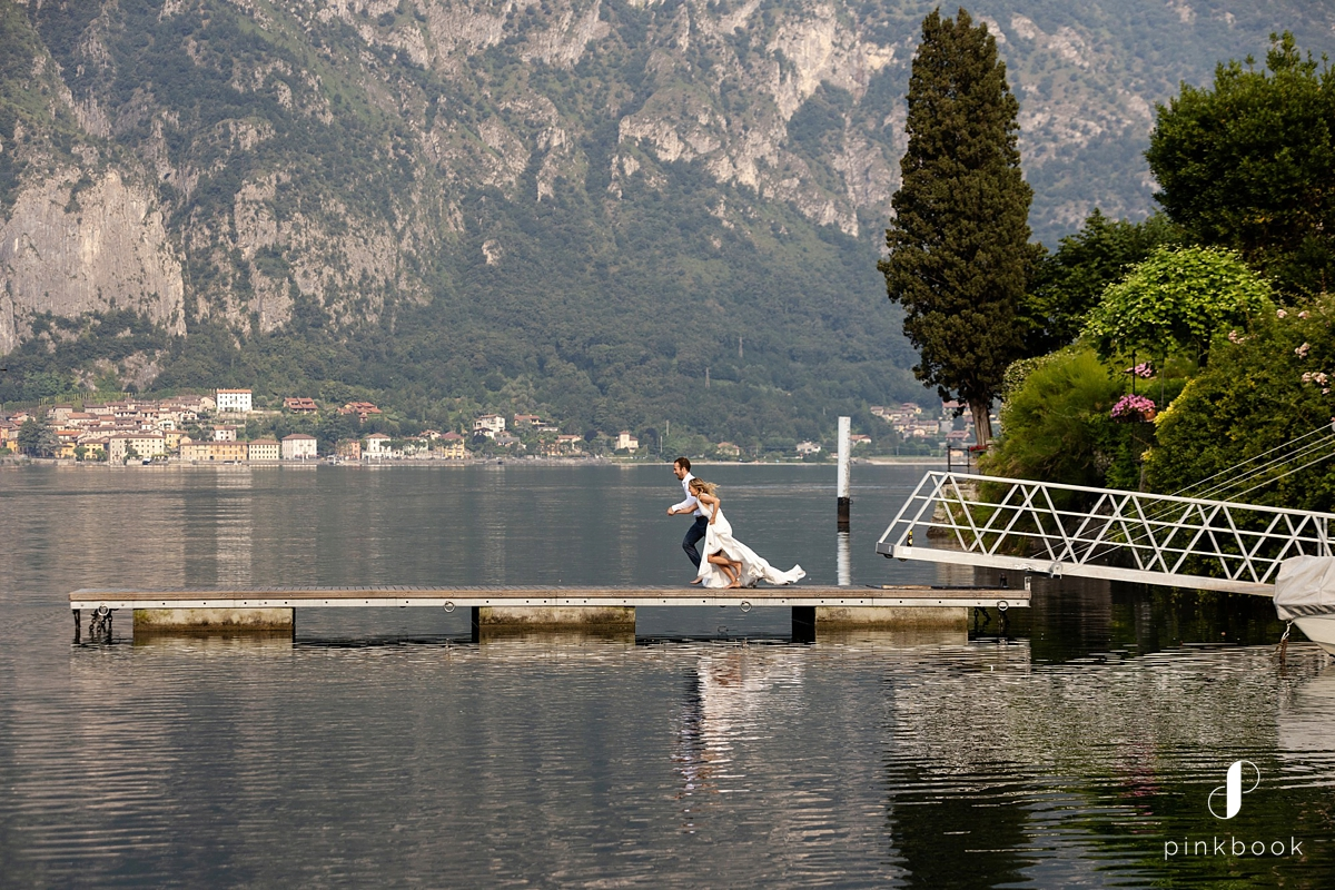 wedding couple jumping in lake