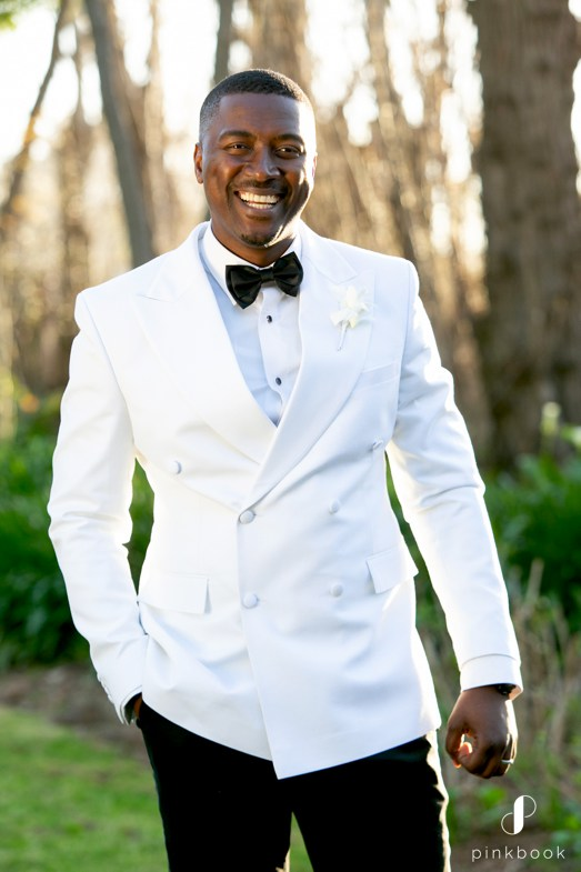 Handsome Groom in White Suit