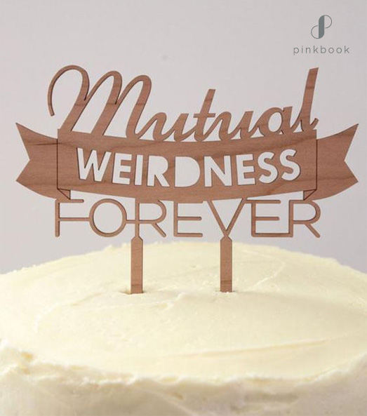 mutual weirdness cake topper